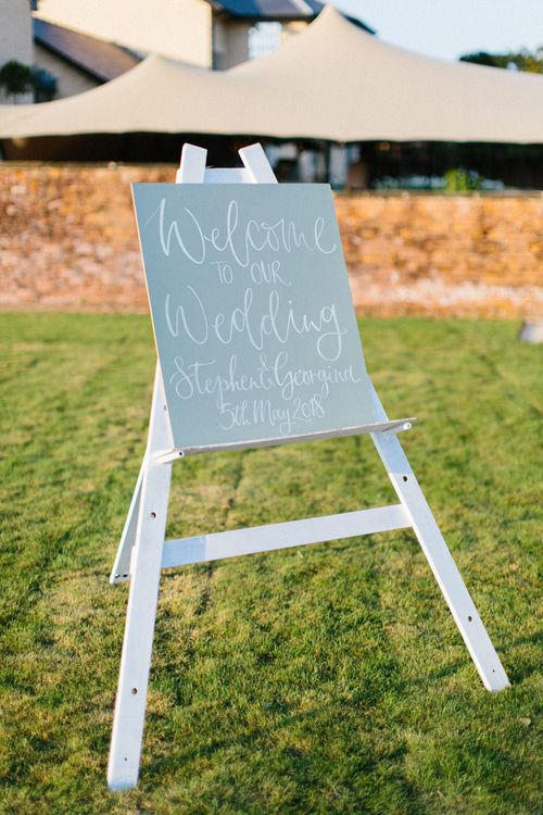 Wooden Signage | Modern calligraphy | Papakata Sperry Tent Wedding at family home | Sassi Holford Dress with added ivory Ostrich feathers to veil | Manolo Blahnik shoes | Images by Melissa Beattie