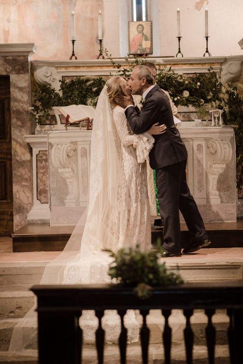 Bride wears bell sleeve wedding dress during Italian wedding