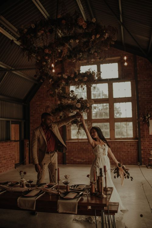 Bride and groom dancing in the Giraffe Shed wedding venue