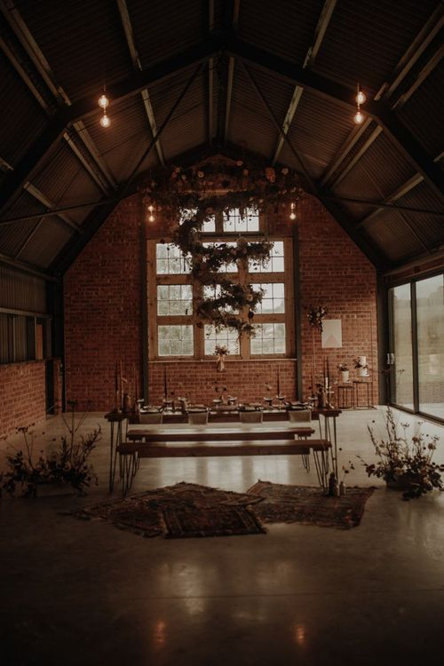 The Giraffe Shed wedding venue with hanging flower spiral