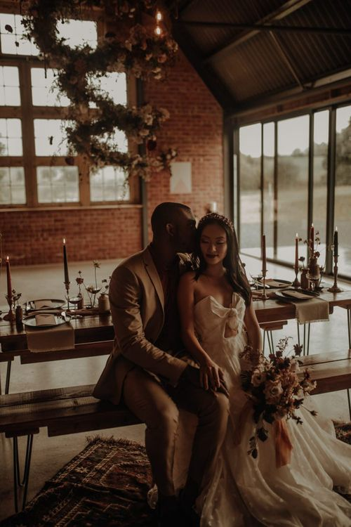 Bride and groom sitting in the Giraffe Shed wedding venue