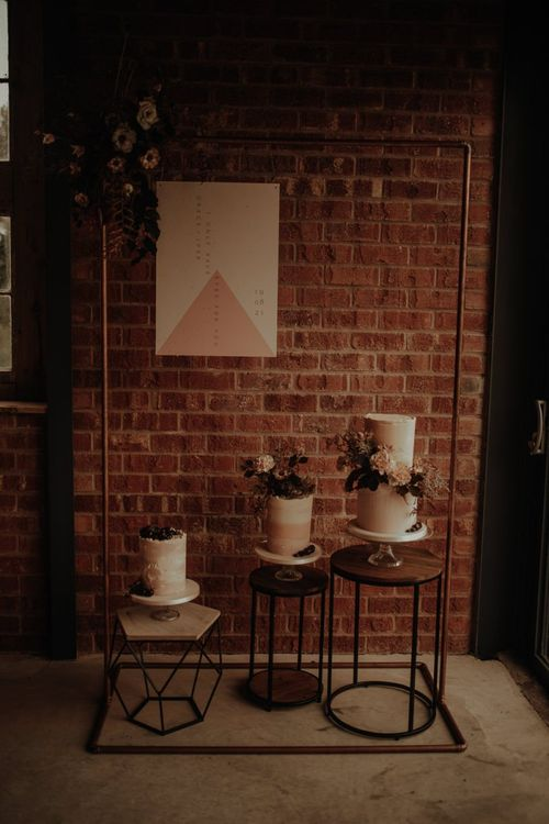 Dessert corner with three wedding cakes  and copper frame
