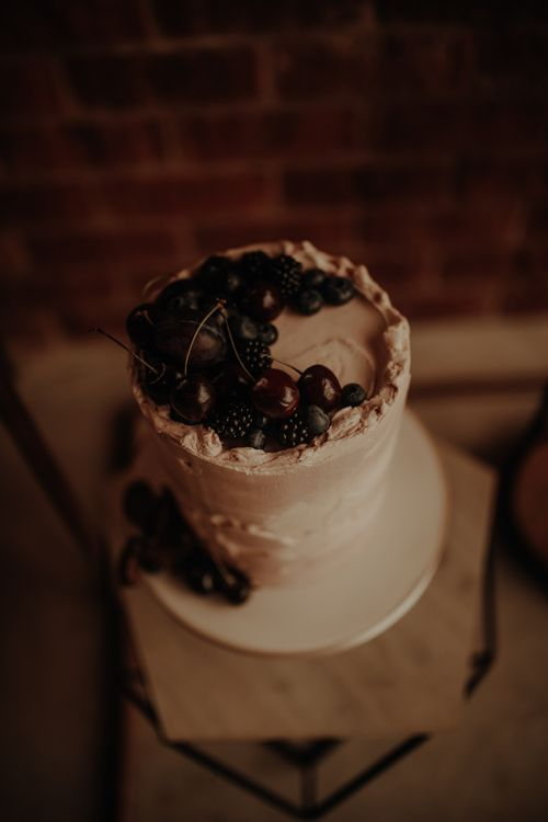 Cherry and blackberry topped wedding cake