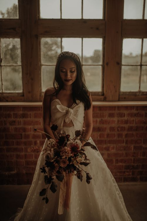 Stylish Asian bride in E&W Couture wedding dress at the Giraffe Shed