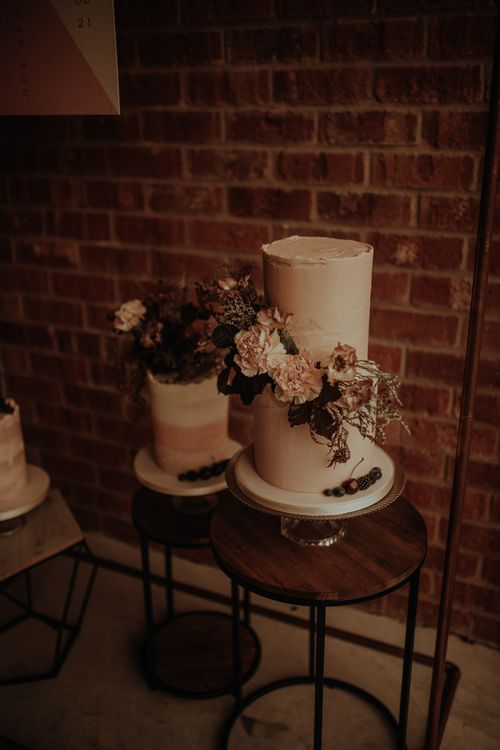 Two tier buttercream wedding cake with flowers