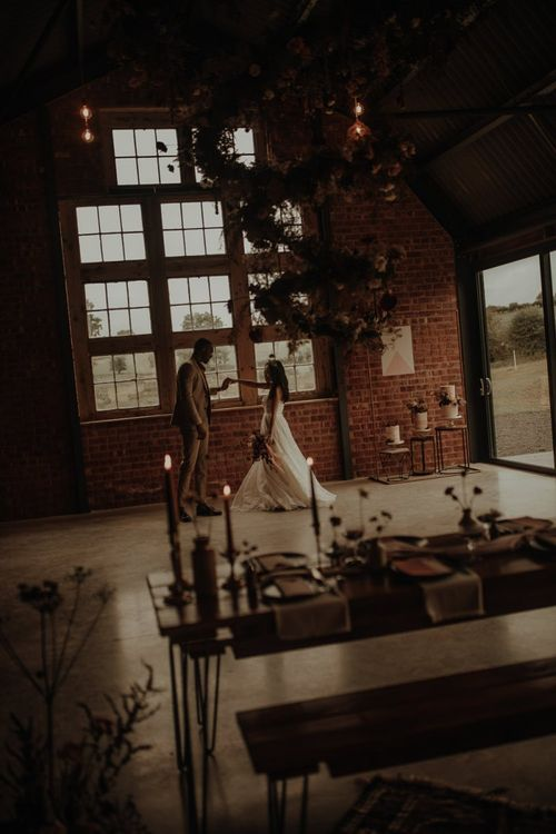 Bride and groom dancing at the Giraffe Shed