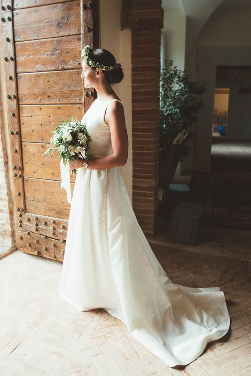 Bride in Jesus Piero Wedding Dress | Mint Green & White Outdoor Ceremony in a Abbazia Montelabate Monastery Cloister & Elegant Reception at Castello Ramazzao Castle, Italy | Maryanne Weddings Photography