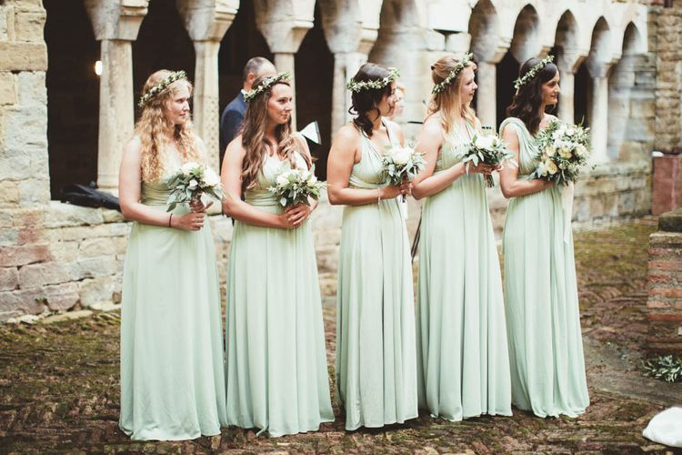 Bridesmaids in Mint Green Dresses | Bride in Jesus Piero Wedding Dress from Morgan Davies Bridal | Groom in Black Suit | Mint Green & White Outdoor Ceremony in a Abbazia Montelabate Monastery Cloister & Elegant Reception at Castello Ramazzao Castle, Italy | Maryanne Weddings Photography