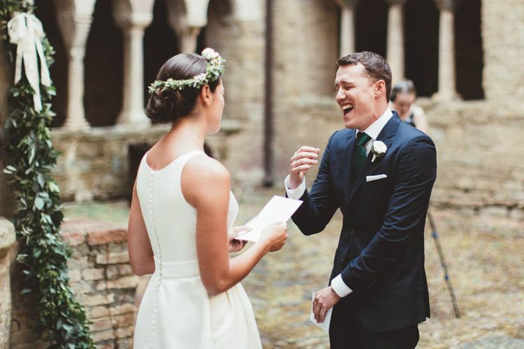 Wedding Vows | Bride in Jesus Piero Wedding Dress from Morgan Davies Bridal | Groom in Black Suit | Mint Green & White Outdoor Ceremony in a Abbazia Montelabate Monastery Cloister & Elegant Reception at Castello Ramazzao Castle, Italy | Maryanne Weddings Photography