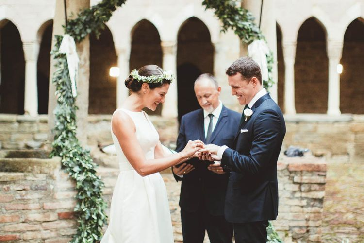 Wedding Ceremony | Bride in Jesus Piero Wedding Dress from Morgan Davies Bridal | Groom in Black Suit | Mint Green & White Outdoor Ceremony in a Abbazia Montelabate Monastery Cloister & Elegant Reception at Castello Ramazzao Castle, Italy | Maryanne Weddings Photography