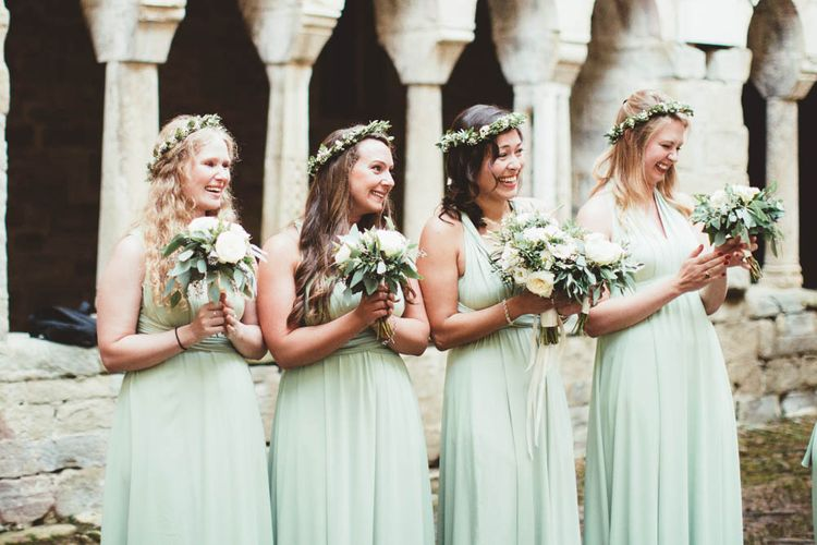 Mint Green Bridesmaids | Bride in Jesus Piero Wedding Dress from Morgan Davies Bridal | Groom in Black Suit | Mint Green & White Outdoor Ceremony in a Abbazia Montelabate Monastery Cloister & Elegant Reception at Castello Ramazzao Castle, Italy | Maryanne Weddings Photography