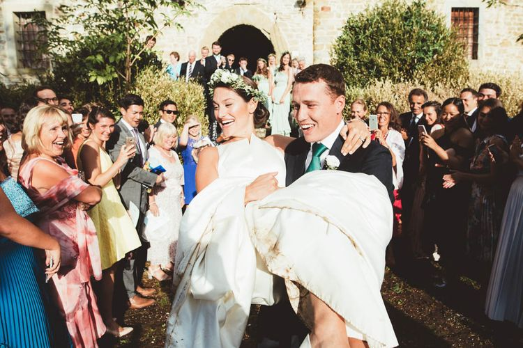 Confetti Exit | Bride in Jesus Piero Wedding Dress from Morgan Davies Bridal | Groom in Black Suit | Mint Green & White Outdoor Ceremony in a Abbazia Montelabate Monastery Cloister & Elegant Reception at Castello Ramazzao Castle, Italy | Maryanne Weddings Photography
