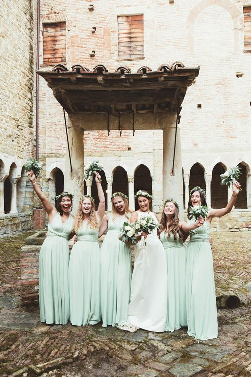 Bridal Party | Bridesmaids in Mint Green Multiway Dresses | Bride in Jesus Piero Wedding Dress from Morgan Davies Bridal | Mint Green & White Outdoor Ceremony in a Abbazia Montelabate Monastery Cloister & Elegant Reception at Castello Ramazzao Castle, Italy | Maryanne Weddings Photography