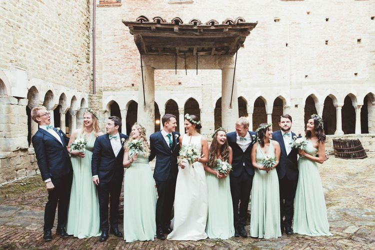 Wedding Party | Bridesmaids in Mint Green Multiway Dresses | Bride in Jesus Piero Wedding Dress from Morgan Davies Bridal | Groomsmen in Black Suits | Mint Green & White Outdoor Ceremony in a Abbazia Montelabate Monastery Cloister & Elegant Reception at Castello Ramazzao Castle, Italy | Maryanne Weddings Photography