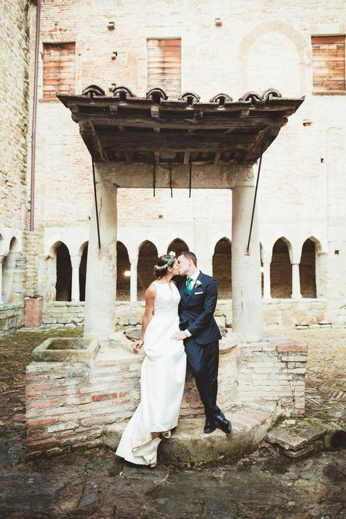 Bride in Jesus Piero Wedding Dress from Morgan Davies Bridal | Groom in Black Suit | Mint Green & White Outdoor Ceremony in a Abbazia Montelabate Monastery Cloister & Elegant Reception at Castello Ramazzao Castle, Italy | Maryanne Weddings Photography