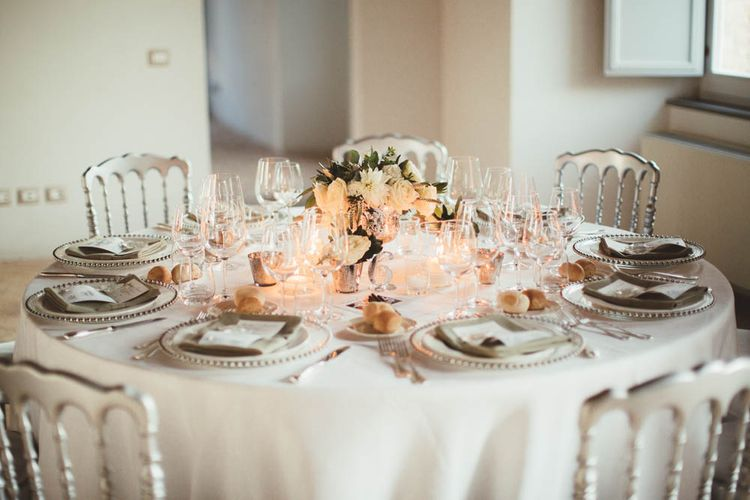 Elegant Silver & White Table Decor | Mint Green & White Outdoor Ceremony in a Abbazia Montelabate Monastery Cloister & Elegant Reception at Castello Ramazzao Castle, Italy | Maryanne Weddings Photography