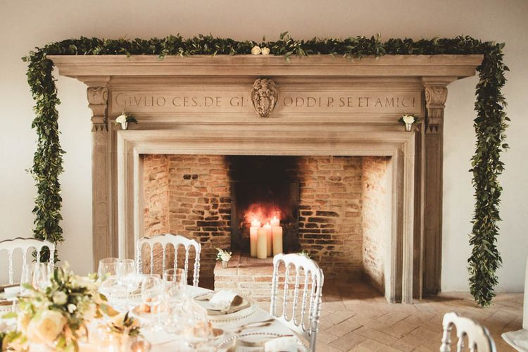 Fireplace with Greenery Garland | Mint Green & White Outdoor Ceremony in a Abbazia Montelabate Monastery Cloister & Elegant Reception at Castello Ramazzao Castle, Italy | Maryanne Weddings Photography