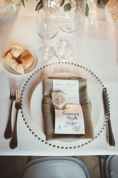 Place Setting with Glass Platter, Grey Napkin & Menu Card | Mint Green & White Outdoor Ceremony in a Abbazia Montelabate Monastery Cloister & Elegant Reception at Castello Ramazzao Castle, Italy | Maryanne Weddings Photography