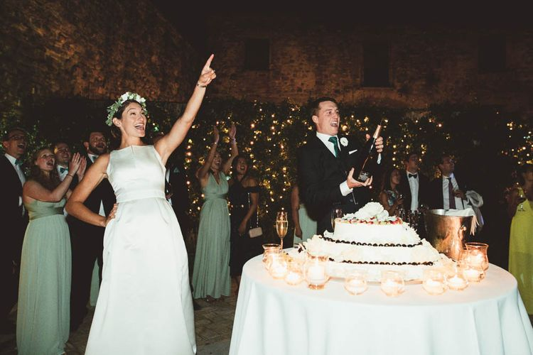 Bride & Groom Cutting the Italian Meringata Wedding Cake | Mint Green & White Outdoor Ceremony in a Abbazia Montelabate Monastery Cloister & Elegant Reception at Castello Ramazzao Castle, Italy | Maryanne Weddings Photography