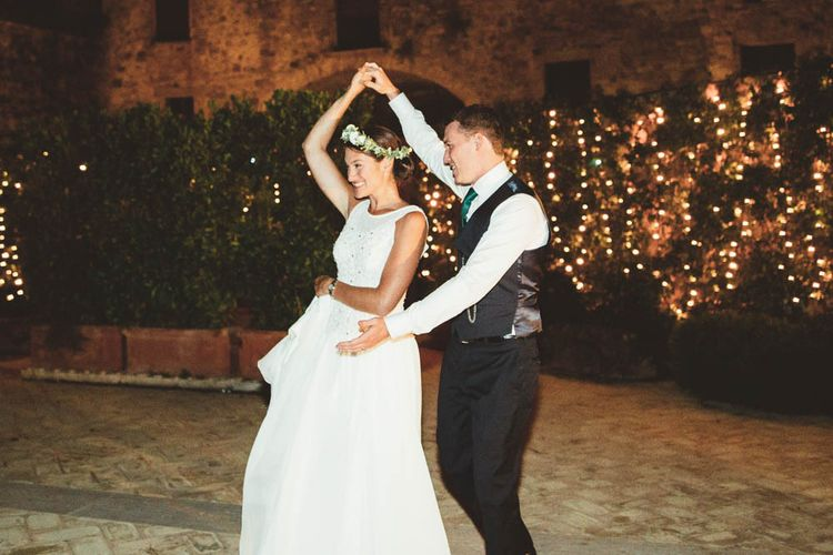 First Dance | Bride in Jesus Piero Gown | Groom in Black Suit | Mint Green & White Outdoor Ceremony in a Abbazia Montelabate Monastery Cloister & Elegant Reception at Castello Ramazzao Castle, Italy | Maryanne Weddings Photography