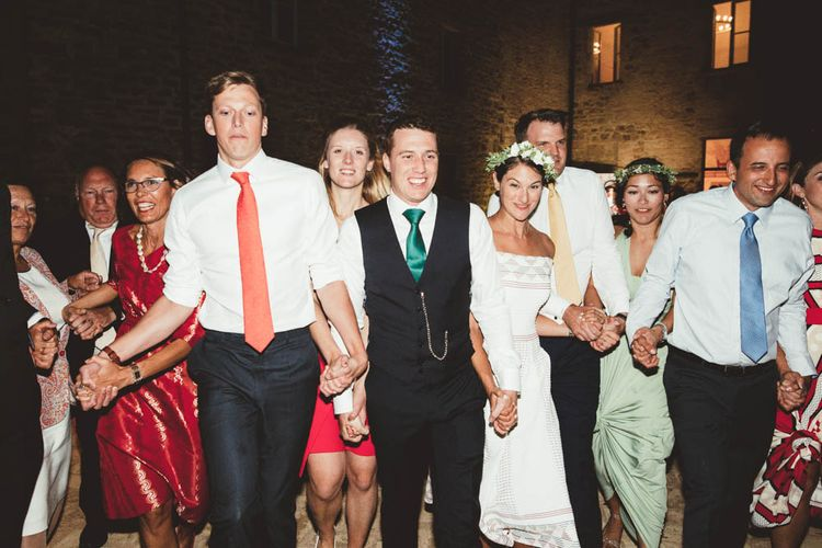 Ceilidh Dance | Bride in Jesus Piero Gown | Groom in Black Suit | Mint Green & White Outdoor Ceremony in a Abbazia Montelabate Monastery Cloister & Elegant Reception at Castello Ramazzao Castle, Italy | Maryanne Weddings Photography