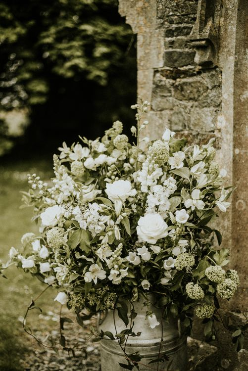 Floral Arrangements In Milk Churns For Wedding // Glasshouse Wedding At Anran In Devon // Image By Paige Grace Photography // Film By The Wild Bride