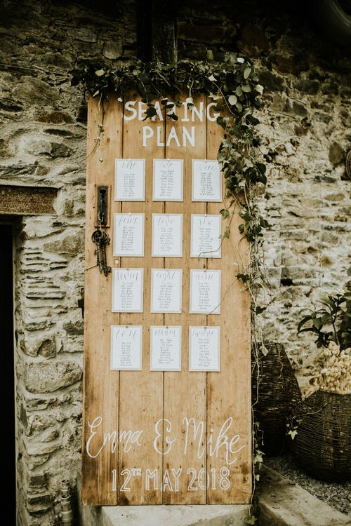Wooden Door Seating Plan // Glasshouse Wedding At Anran In Devon // Image By Paige Grace Photography // Film By The Wild Bride
