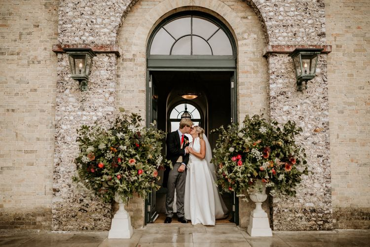 Large Floral Displays In Urns // Image By Green Antlers Photography
