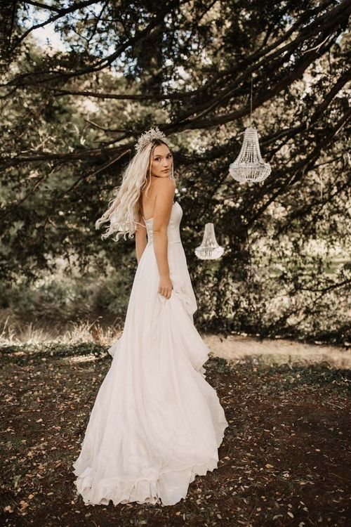 Bride in strapless wedding dress with jewelled crown