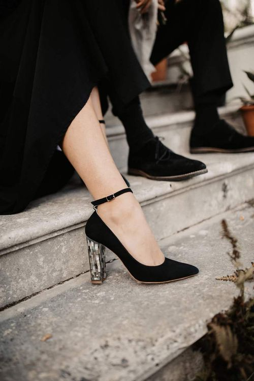 Black ankle strap shoes with tortoise shell heels