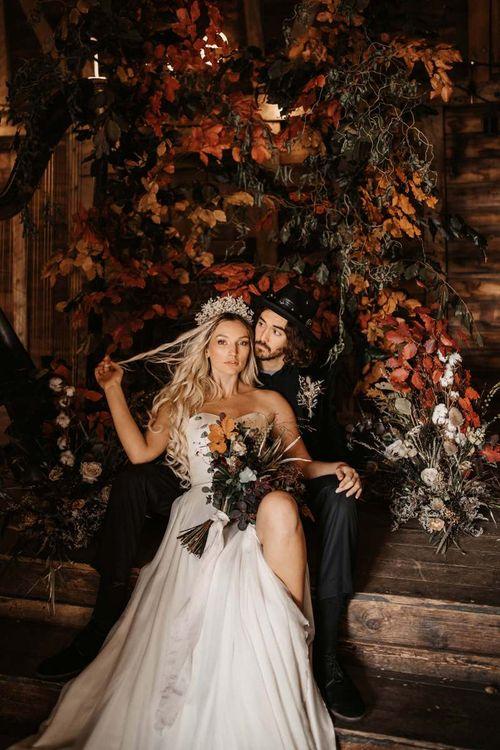 Stylish bride and groom at Halloween wedding