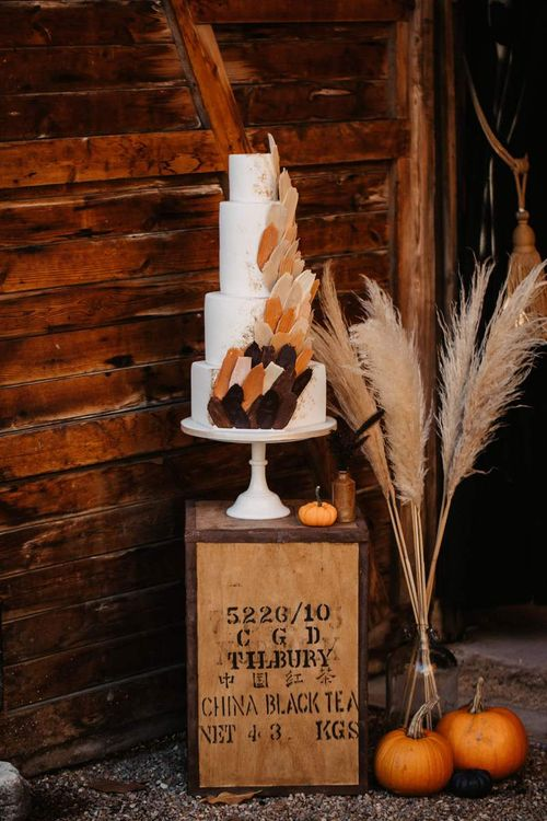 Wedding cake with pumpkins, crates and dried flower Halloween wedding decor