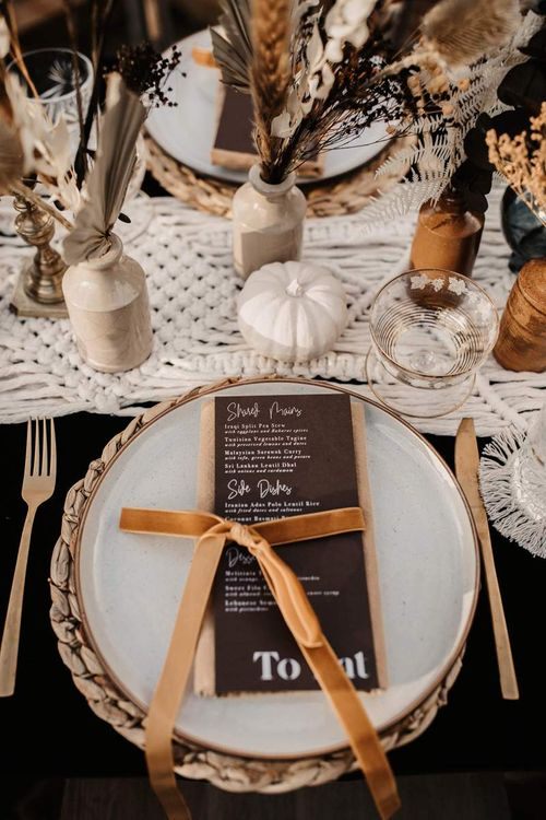 Place setting in Autumn wedding colours for Halloween wedding