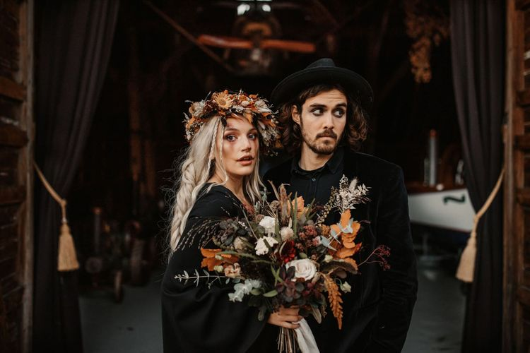 Bride with orange and dried flower bouquet and flower crown at Halloween wedding shoot
