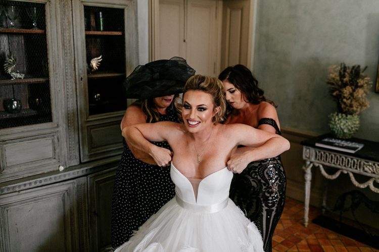Bride Getting into Her Wedding Dress on the Wedding Morning
