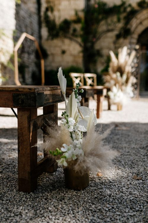 Tropical Aisle Wedding Flowers with Palm Leaves and Orchids