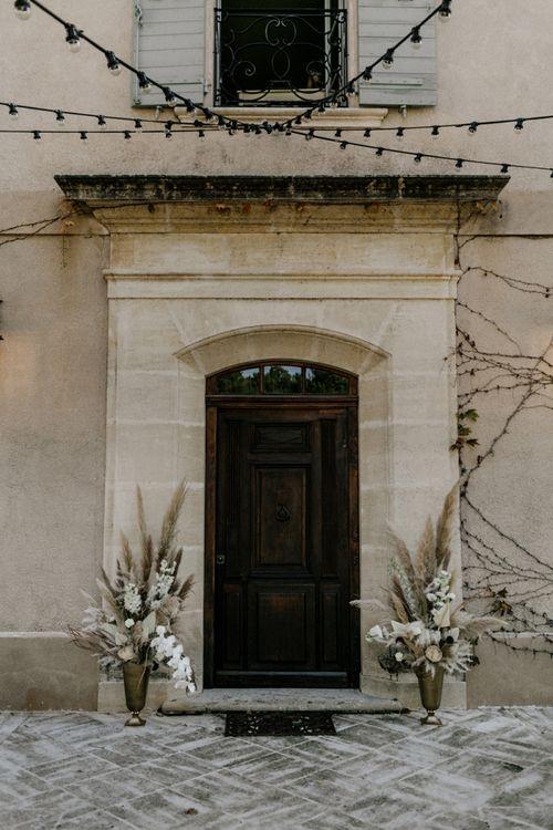 Natural Wedding Venue Flower Arrangements in Gold Pots