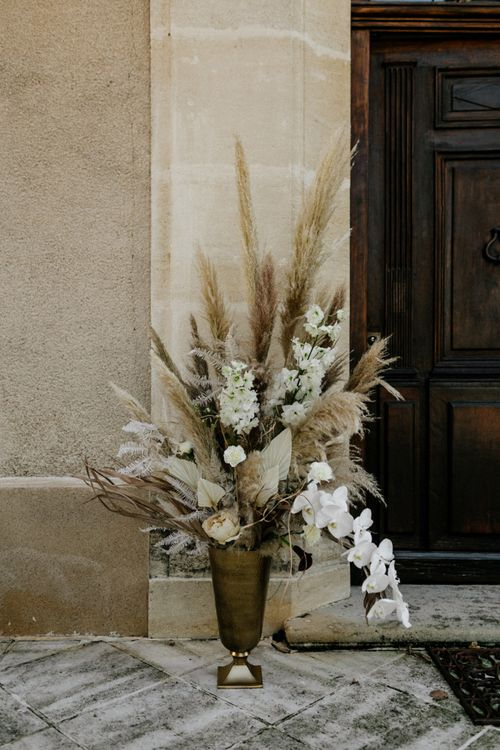 Cream and Beige Wedding Flower Arrangement with Pampas Grass and Orchids