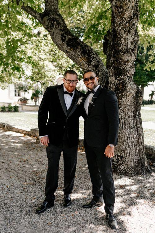 Groom and Best Man in Black Tie Suits