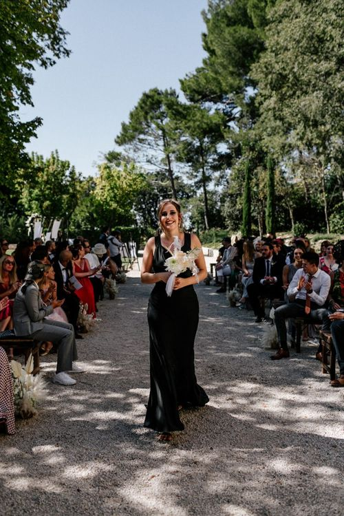 Bridesmaid in Fitted Black Dress Walking Down the Aisle