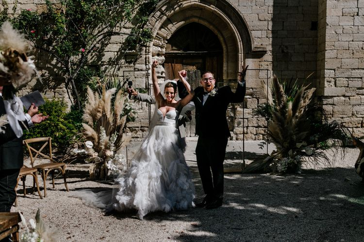 Bride and Groom Celebrating After Being Just Married