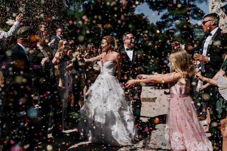 Colourful Confetti Moment with Bride and Groom Celebrating