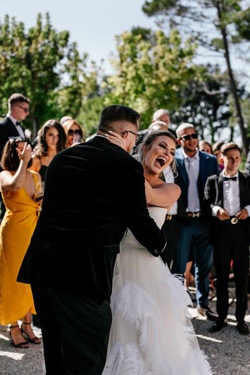 Groom Embracing His Surprised Bride
