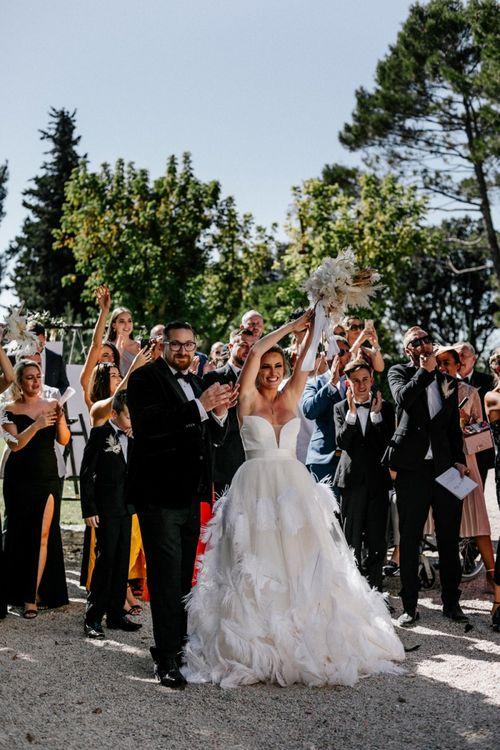 Bride and Groom Applauding the Wedding Choir