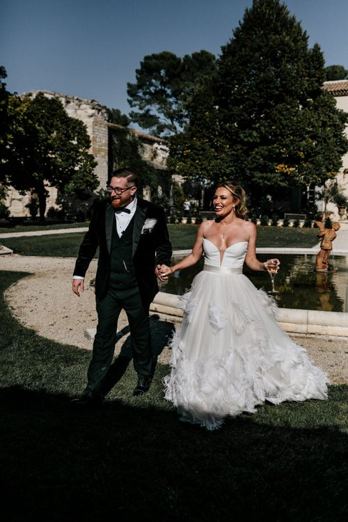 Stylish Bride in Stephanie Allin Feather Wedding Dress and Groom in Black Tie Suit with Bow Tie
