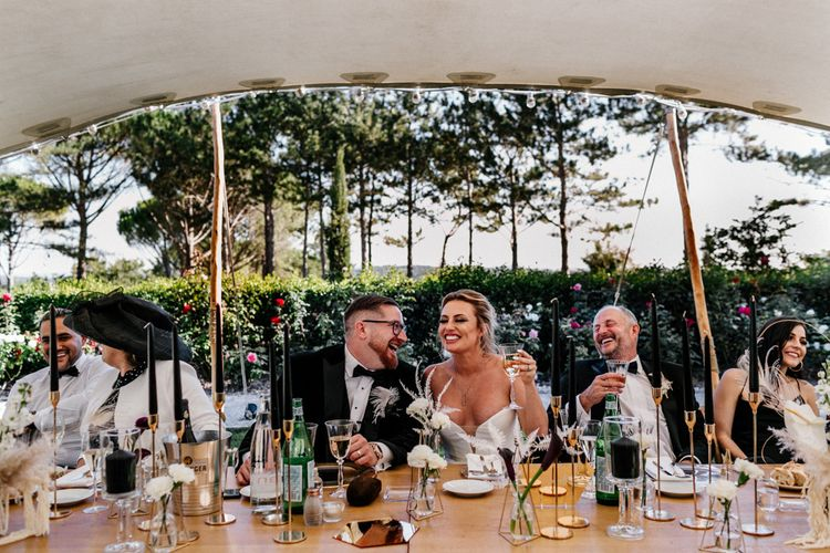 Bride and Groom Laughing During Stretch Tent Wedding Reception