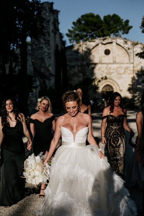 Stunning Bride Walking with Her Bridal Party Through The French Chateau