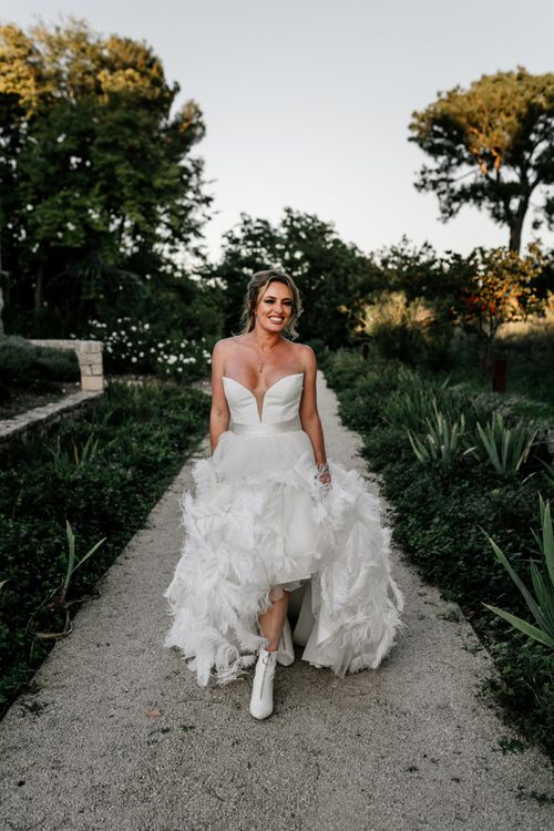 Stylish Bride in Stephanie Allin Wedding Dress with Feather Skirt and Sweetheart Neckline Bodice and Bridal Boots