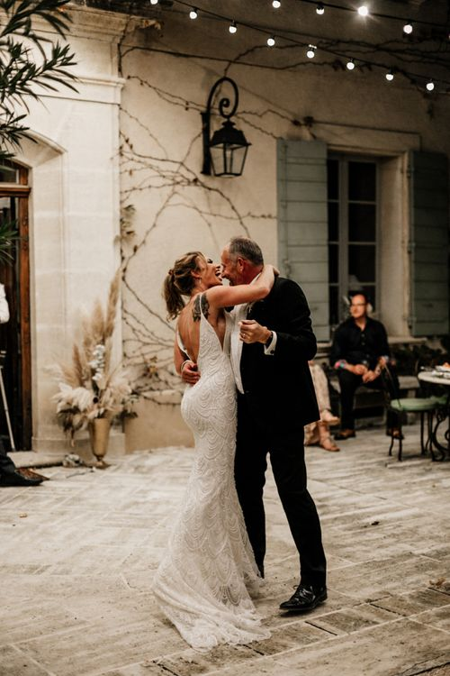 Bride in Embellished Fitted Wedding Dress Dancing with Her Father