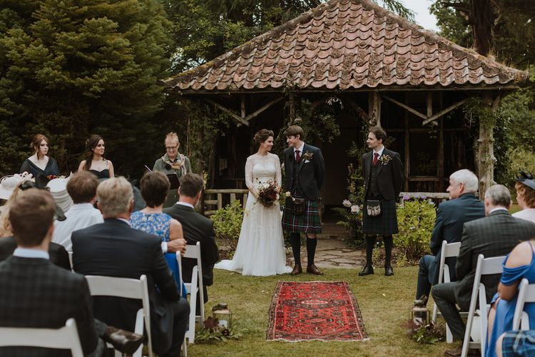 Outdoor Humanist Wedding Ceremony with Bride in Wendy Makin French Collection Yvonne Wedding Dress and Groom in Tartan Kilt